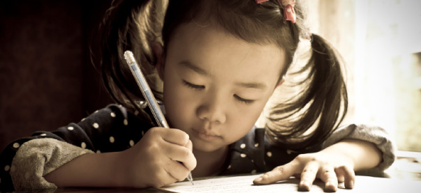 little girl writing.jpg