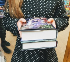 Ella holding books